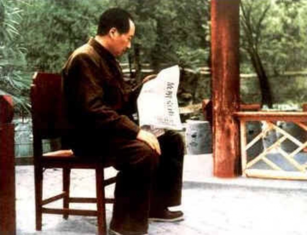 Mao Zedong reading a report about the occupation on Nanking at the Shuangqing Villa in the Western Hills outside Beiping, April 1949