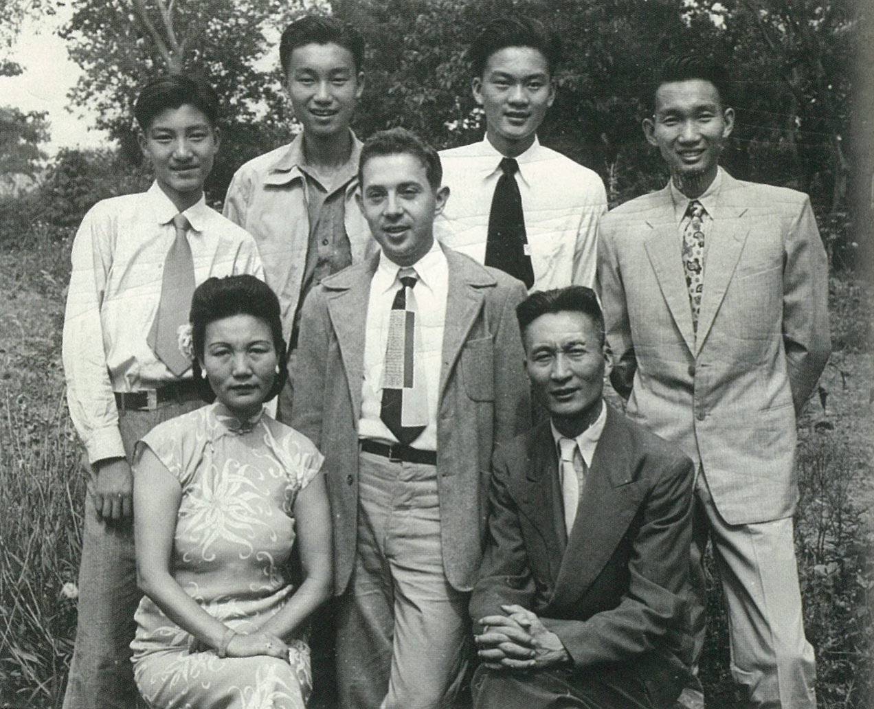 "Fig.7. The author with the Sie (Hsieh, Xie) family with whom he 'lived for almost four years in Nanking, 1946-1950, while a student at the University of Nanking.' Seated in front, Mrs. Sie (Zhang Shaoliang) and Mr. Sie (Xie Xiang). From left to right standing at back: Willie 14, 5' 8"" (Xie Lie); John 18, 6' 2"" (Xie Ran); Paul 19, 6' 3"" (Xie Tao); Peter 23, 6' 1"" (Xie Jie). 'Mrs. Sie came out the worst of the lot of us, cause she isn't smiling. Not typical of her. (I think Willy was pinching John and had just been scolded for it by his mom, which explains those three expressions.) June 6, 1948.' Passages in quotation marks and the heights and ages of the sons are taken from the author's caption written on the back of the photograph. From the author's papers."