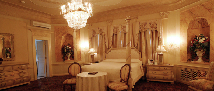 A bedroom at the Mar-a-Lago resort, ready for an embalmed corpse and votive offerings