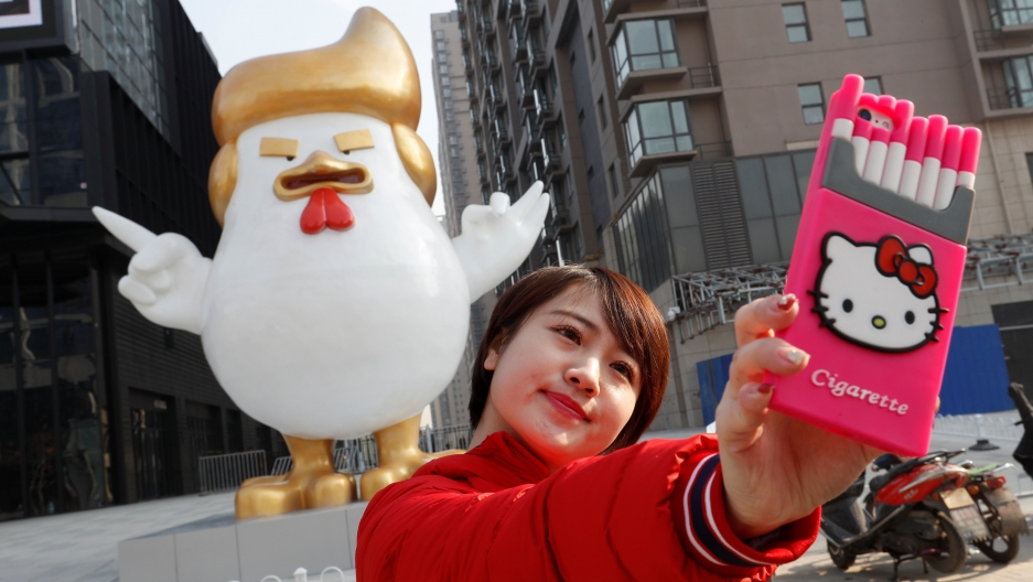 A selfie with blow-up Cock Trump. John Woo / Reuters